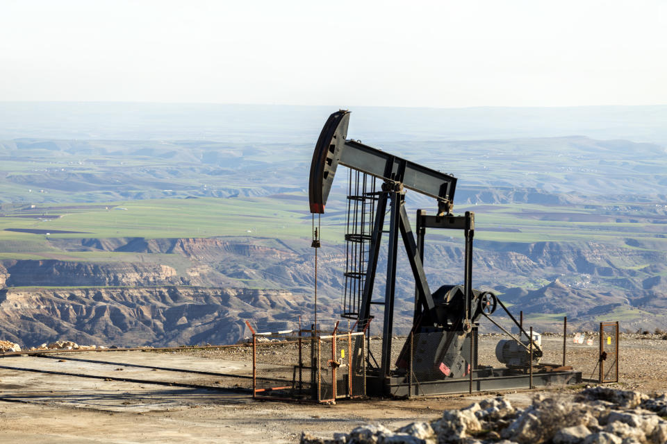View of the pumpjack in the oil well of the oil field. The arrangement is commonly used for onshore wells producing little oil. Pumpjacks are common in oil-rich areas.