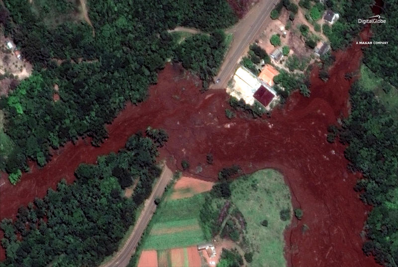 This Jan. 29, 2019 satellite image provided by DigitalGlobe shows mud flooding an area days after a Jan. 25 mining company's dam collapsed, near Brumadinho, Brazil. As search-and-recovery efforts continued, authorities also worked to slow the reddish-brown mud that was heading down a small river with high concentrations of iron oxide, threatening to contaminate a much larger waterway that provides drinking water to communities in five of the country's 26 states. (DigitalGlobe, a Maxar company via AP)