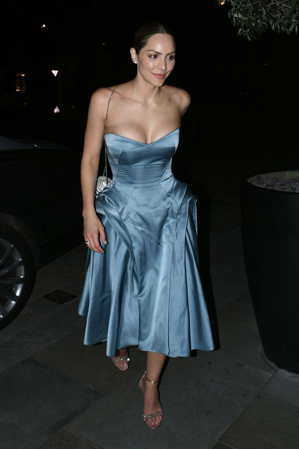 <p>For Broadway star Katharine McPhee's third and final look at her wedding to David Foster she wore a smokey blue satin midi length cocktail dress by Zac Posen where they cut the cake and hit the dance floor. Matching with a sphere crystal embellished clutch and sandals. </p>