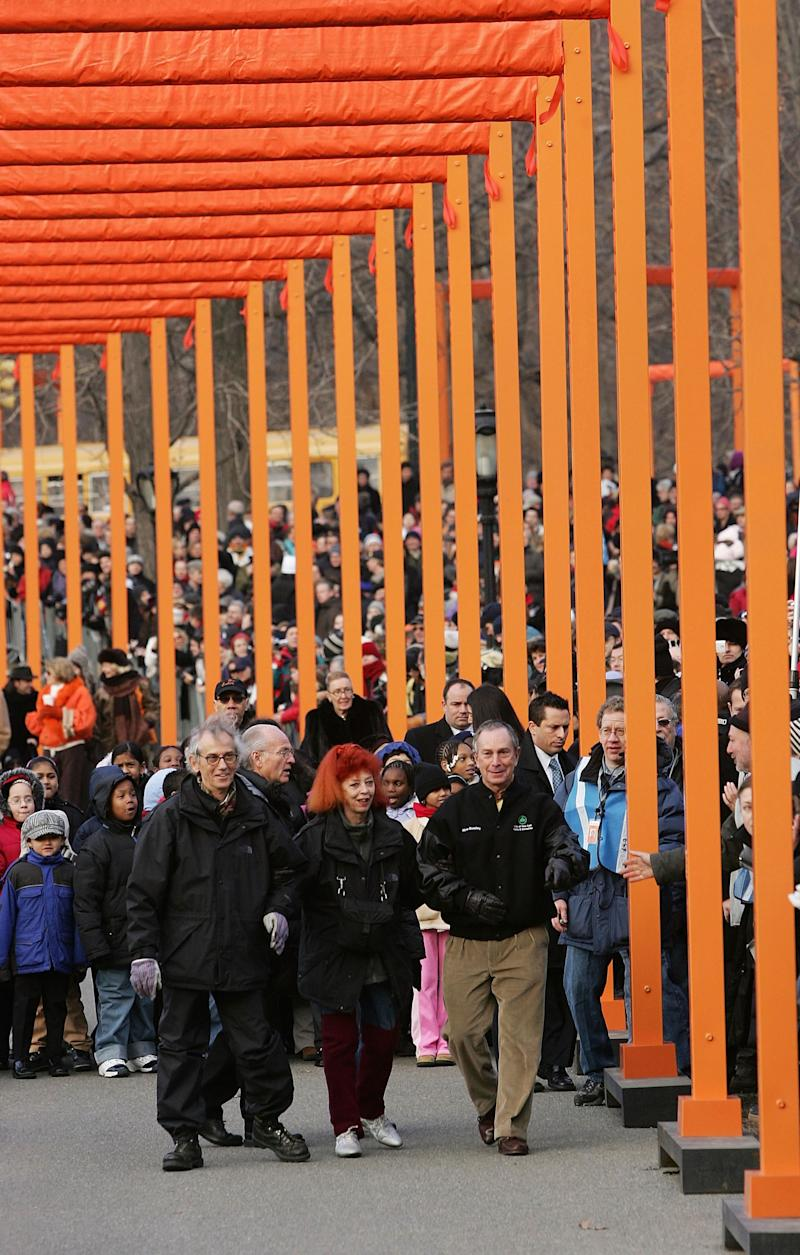 Christo and Jeanne-Claude with New York City mayor Michael Bloomberg, walking through The Gates in New York's Central Park.