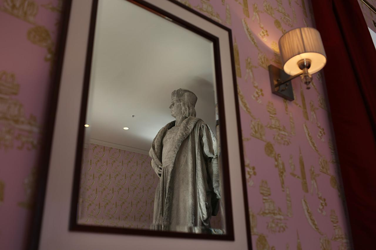 "NEW YORK, NY - SEPTEMBER 19:  The iconic 13-foot statue of Christopher Columbus is viewed from the 810-square-foot ""living room"" art installation by Japanese artist Tatzu Nishi on September 19, 2012 in New York City. Viewed as a piece of conceptual art, ""Living Room"", which sits 70-feet above ground level and is only accessible via a scaffold-encased staircase, has been temporarily built around the Columbus Monument in Columbus Circle. Beginning Thursday, up to 25 people at a time can enter the living room to view up close the 1892 marble figure of the Italian explorer.  (Photo by Spencer Platt/Getty Images)"