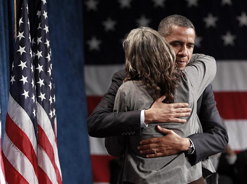 President Barack Obama, embraces Tami Graham as he is introduced to supporters at a campaign fundraiser, Wednesday, May 23, 2012 in Denver. (AP Photo/Pablo Martinez Monsivais)