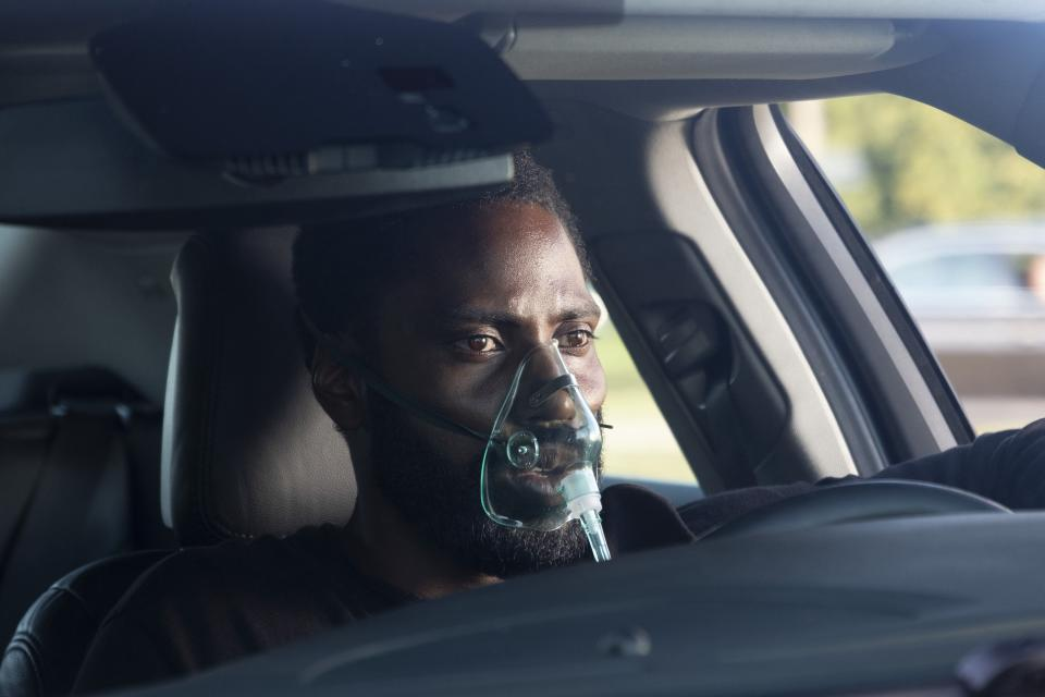 John David Washington as the unnamed Protagonist in Tenet.
