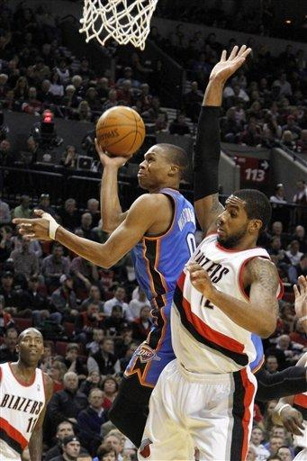 Oklahoma City Thunder guard Russell Westbrook, left, goes to the basket against Portland Trail Blazers forward LaMarcus Aldridge during the first half of their NBA basketball game in Portland, Ore., Monday, Feb. 6, 2012.(AP Photo/Don Ryan)