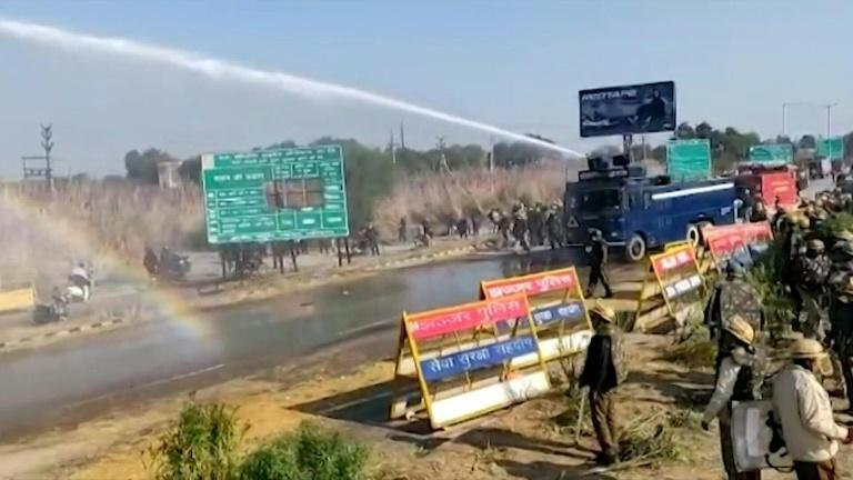 Indian police fire tear gas and water cannon in a second day of clashes with farmers marching on New Delhi