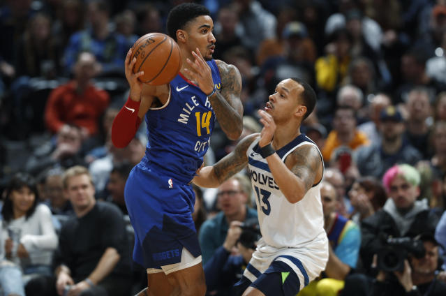 Denver Nuggets guard Gary Harris, left, looks to pass the ball as Minnesota Timberwolves guard Shabazz Napier defends in the first half of an NBA basketball game Friday, Dec. 20, 2019, in Denver. (AP Photo/David Zalubowski)