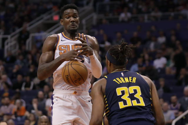 Indiana Pacers center Myles Turner (33) knocks the ball away from Phoenix Suns center Deandre Ayton (22) during the second half of an NBA basketball game, Wednesday, Jan. 22, 2020, in Phoenix. (AP Photo/Matt York)