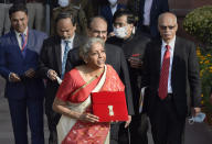 NEW DELHI, INDIA - FEBRUARY 1: Union Minister of Finance Nirmala Sitharaman seen holding the Budget folder (bahi khata) along with Minister of State in the Ministry of Finance Anurag Thakur and other senior officials before leaving from Ministry of Finance to the Parliament to present Union Budget 2021-22, on February 1, 2021 in New Delhi, India. (Photo by Ajay Aggarwal/Hindustan Times via Getty Images)