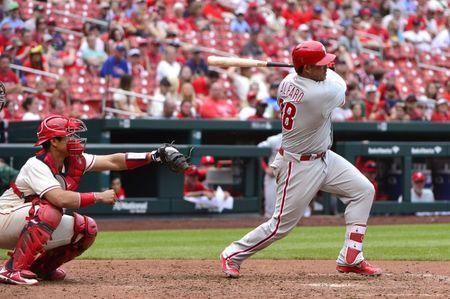 May 19, 2018; St. Louis, MO, USA; Philadelphia Phillies pinch hitter Jorge Alfaro (38) hits a one run single off of St. Louis Cardinals relief pitcher Greg Holland (not pictured) during the eighth inning at Busch Stadium. Mandatory Credit: Jeff Curry-USA TODAY Sports