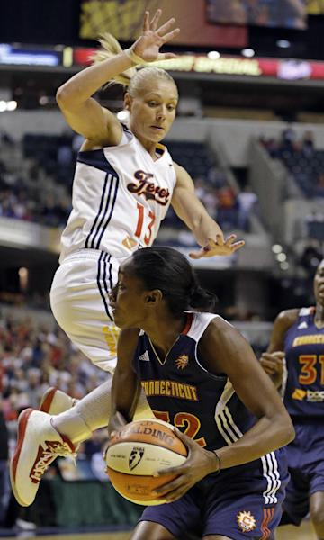 Connecticut Sun's Kalana Greene is fouled by Indiana Fever's Erin Phillips (13) as she goes up for a shot during the first half of Game 2 of the WNBA basketball Eastern Conference Finals Monday, Oct. 8, 2012, in Indianapolis. (AP Photo/Darron Cummings)