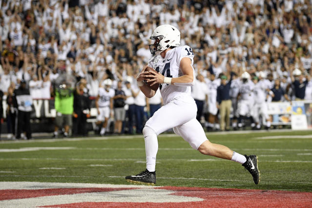Penn State quarterback Sean Clifford scores a touchdown during the first half of an NCAA college football game against Maryland, Friday, Sept. 27, 2019, in College Park, Md. (AP Photo/Nick Wass)