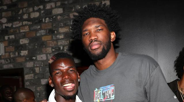 <p>Paul Pogba and Philadelphia 76ers center Joel Embiid pose together–even though Embiid is a Chelsea fan.</p>