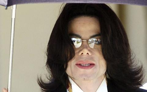 Michael Jackson leaving the Santa Barbara county courthouse in 2005 after a former employee of his Neverland ranch took the stand to dispute the testimony of a maid who claimed the pop star inappropriately touched actor Macaulay Culkin and other boys - Credit: Phil Klein/Reuters