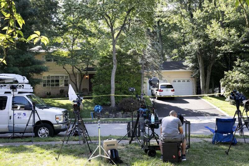 News media is set up in front of the home of U.S. District Judge Esther Salas, Monday, July 20, 2020, in North Brunswick, N.J. A gunman posing as a delivery person shot and killed Salas' 20-year-old son and wounded her husband Sunday evening at their New Jersey home before fleeing, according to judiciary officials. (AP Photo/Mark Lennihan)