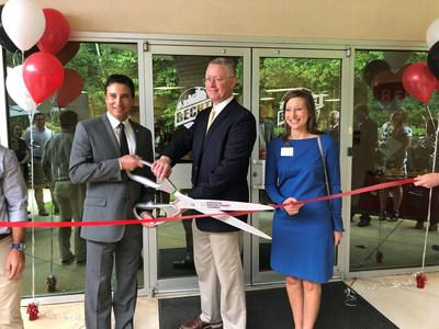 Bechtel's Defense and Space General Manager Mike Costas and Engineering Manager Nathan McAdams cut the ribbon on the new Bechtel Huntsville office with Amber Greenwood of the Huntsville/Madison County Chamber.