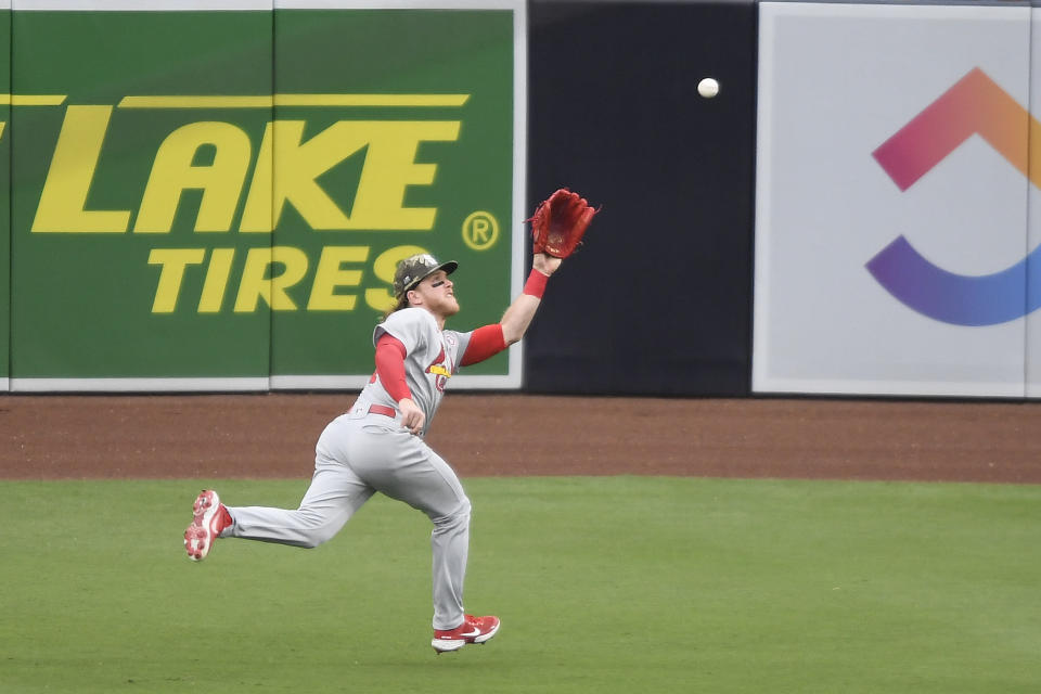 St. Louis Cardinals center fielder Harrison Bader catches a ball hit by San Diego Padres' Manny Machado during the second inning of a baseball game Saturday, May 15, 2021, in San Diego. (AP Photo/Denis Poroy)