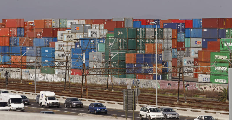 "Vehicles drive on a main highway with shipping containers in the background, in Cape Town, South Africa, Friday, Sept. 27, 2013. Scientists are more certain than ever that humans are causing the majority of climate change - with significant impact for the planet, a key report has shown. The first part of the Intergovernmental Panel on Climate Change's (IPCC) fifth assessment report shows that global warming is ""unequivocal"" and human influence on the climate is clear. (AP Photo/Schalk van Zuydam)"