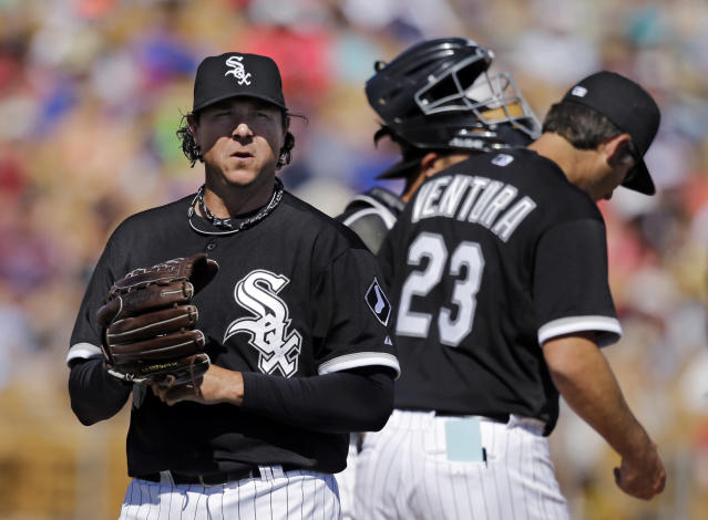 Chicago White Sox relief pitcher Scott Downs leaves a spring exhibition baseball game against the Chicago Cubs after giving up a home run to Cubs' Luis Valbuena in the seventh inning Friday, March 21, 2014, in Glendale, Ariz. (AP Photo/Mark Duncan)