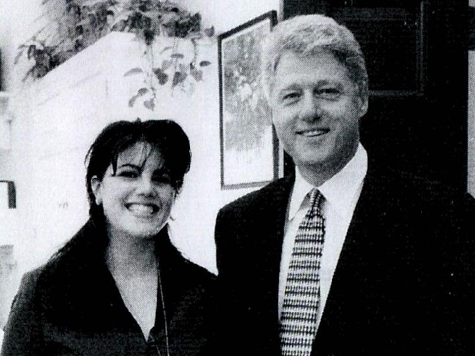A photograph showing former White House intern Monica Lewinsky meeting President Bill Clinton at a White House function submitted as evidence in documents by the Starr investigation and released by the House Judiciary committee on 21 September 1998 (Getty Images)