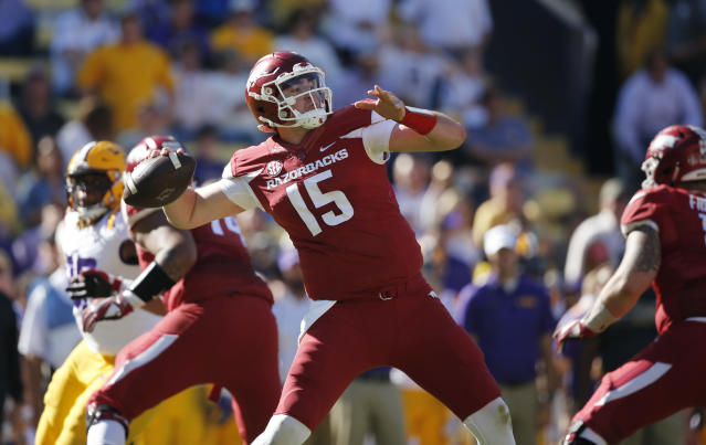 "Arkansas quarterback <a class=""link rapid-noclick-resp"" href=""/ncaaf/players/266541/"" data-ylk=""slk:Cole Kelley"">Cole Kelley</a> (15) passes in the second half of an NCAA college football game against LSU in Baton Rouge, La., Saturday, Nov. 11, 2017. LSU won 33-10. (AP Photo/Gerald Herbert)"