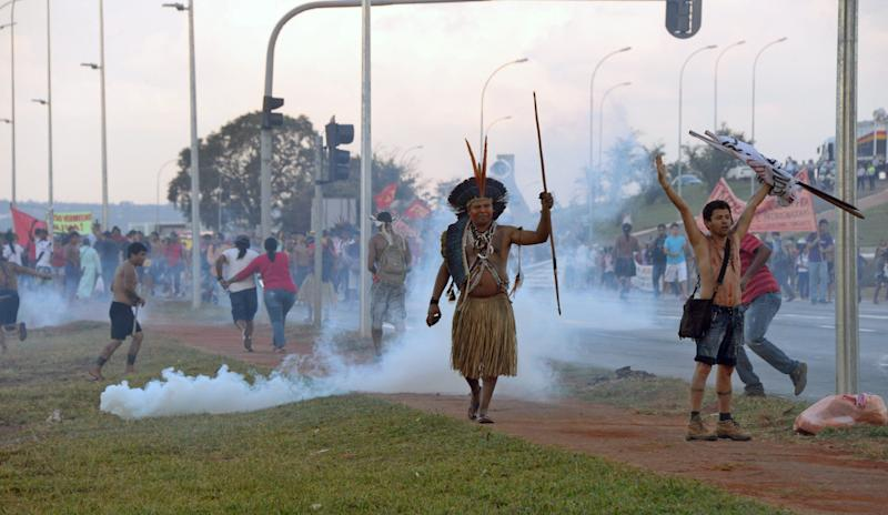 An indigenous man protests against the upcoming FIFA World Cup in Brasilia
