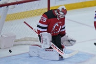 New Jersey Devils goaltender Mackenzie Blackwood reacts after being scored on during the second period of the NHL hockey game against the New York Rangers in Newark, N.J., Sunday, April 18, 2021. (AP Photo/Seth Wenig)