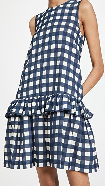"""<p><strong>Victoria Victoria Beckham</strong></p><p>shopbop.com</p><p><strong>$515.00</strong></p><p><a href=""""https://go.redirectingat.com?id=74968X1596630&url=https%3A%2F%2Fwww.shopbop.com%2Fsleeveless-flounce-hem-printed-faille%2Fvp%2Fv%3D1%2F1594273747.htm&sref=https%3A%2F%2Fwww.townandcountrymag.com%2Fstyle%2Fg35967684%2Fwhat-to-wear-to-get-vaccinated%2F"""" rel=""""nofollow noopener"""" target=""""_blank"""" data-ylk=""""slk:Shop Now"""" class=""""link rapid-noclick-resp"""">Shop Now</a></p><p>Take the preppy route with a <a href=""""https://www.townandcountrymag.com/style/fashion-trends/g31214026/best-gingham-fashion/"""" rel=""""nofollow noopener"""" target=""""_blank"""" data-ylk=""""slk:gingham"""" class=""""link rapid-noclick-resp"""">gingham</a> printed faille dress with a drop waist. </p>"""