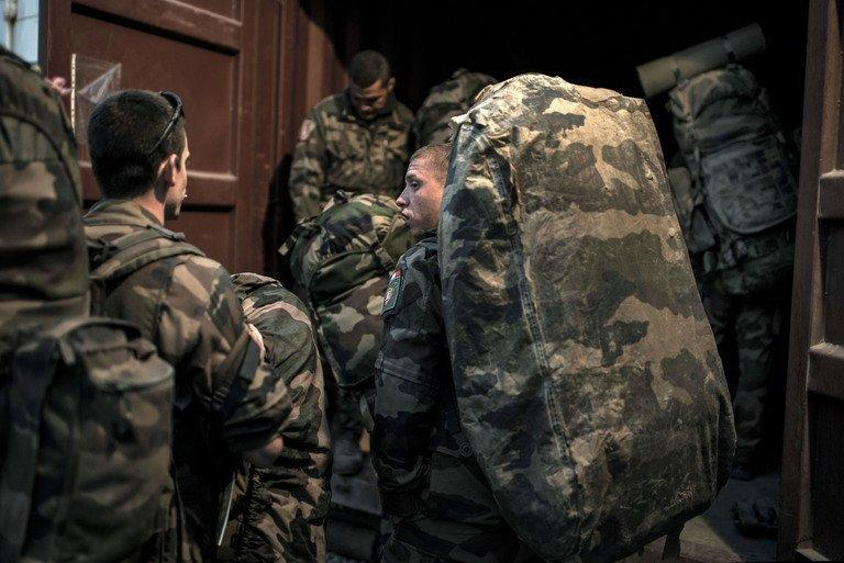 French soldiers load their bags into a container before leaving Afghanistan on Septembre 29, 2012. France has flown its last combat troops out of Afghanistan, two years before allied nations in the 100,000-strong NATO mission led by the United States are due to recall their fighting forces