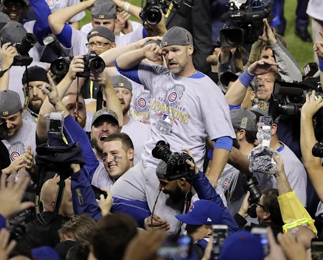 <p>Chicago Cubs' David Ross is carried by teammates after Game 7 of the Major League Baseball World Series against the Cleveland Indians Thursday, Nov. 3, 2016, in Cleveland. The Cubs won 8-7 in 10 innings to win the series 4-3. (AP Photo/Gene J. Puskar) </p>
