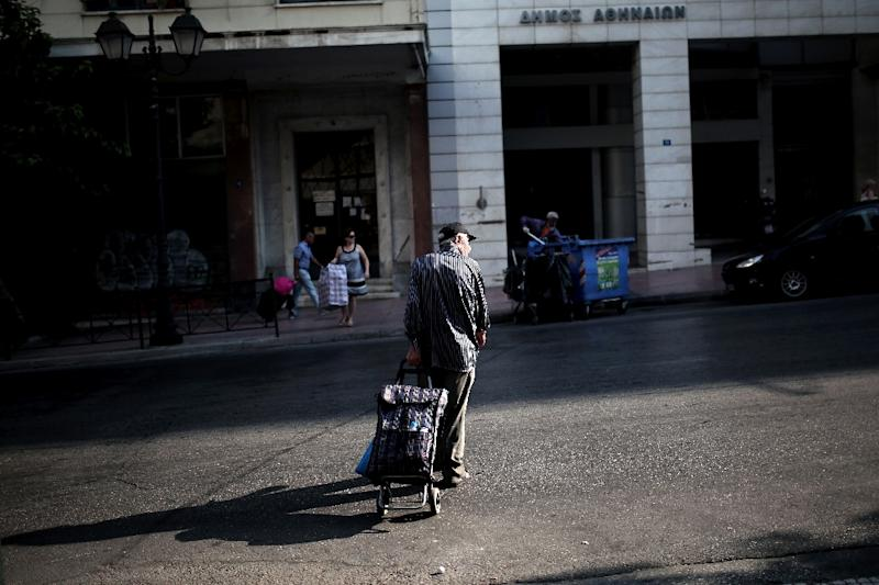 One advantage of capital controls has been to encourage Greeks to use bank transfers and card payments (AFP Photo/Angelos Tzortzinis)