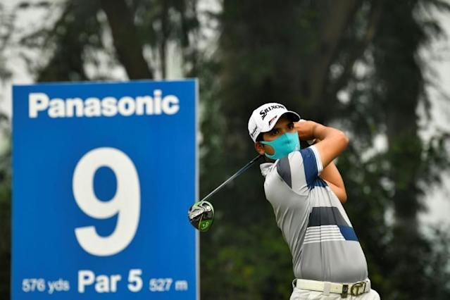 Thailand's Itthipat Buranatanyarat was one of several players who donned a face mask to play in the Panasonic Open India golf tournament (AFP Photo/Paul LAKATOS)
