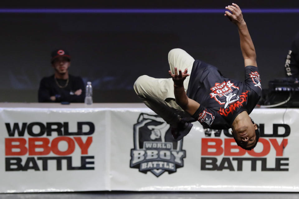 Bboy Gravedad, of the Dominican Republic, competes during the World Bboy Battle Saturday, Dec. 21, 2019, in New York. Many in the breaking community are eager for the art form to expand its audience after the International Olympic Committee announced that it would become an official sport at the Paris 2024 games. But that optimism is hardly unanimous. (AP Photo/Frank Franklin II)