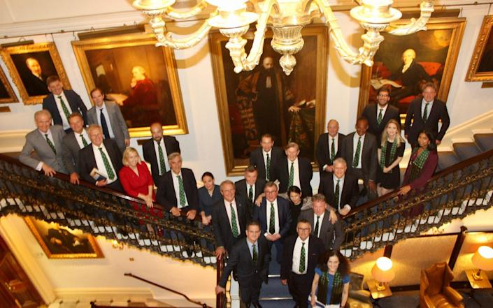 The 'Spartans' gather on the stairs of the Carlton Club after their celebratory dinner