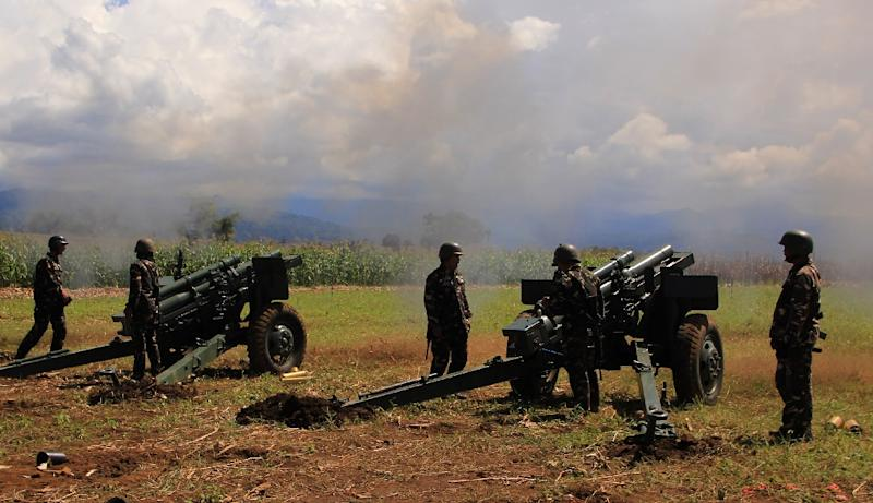 Philippine troops fire their 105mm howitzer cannons towards Islamic militant group positions from their base near Butig town in Lanao del Sur province, on the southern island of Mindanao, on November 27, 2016