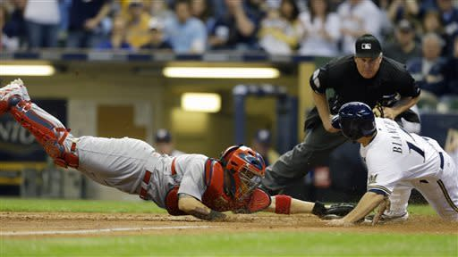 Milwaukee Brewers' Jeff Bianchi, right, scores ahead of the tag by St. Louis Cardinals' Yadier Molina, left, during the eight inning of a baseball game on Saturday, May 4, 2013, in Milwaukee. Home plate umpire Bill Miller watches the play. (AP Photo/Jeffrey Phelps)