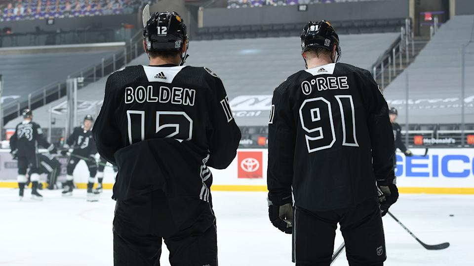 Kings' Trevor Moore and Carl Grundstrom warm up while wearing jerseys honouring Black hockey trailblazers Willie O'Ree and Blake Bolden. (Photo by Andrew D. Bernstein/NHLI via Getty Images)