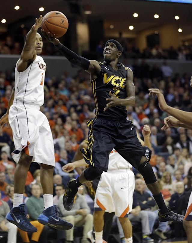 Virginia Commonwealth guard Briante Weber (2) drives to the basket as Virginia guard Justin Anderson (1) defends during the first half of an NCAA college basketball game in Charlottesville, Va., Tuesday, Nov. 12, 2013. (AP Photo/Steve Helber)