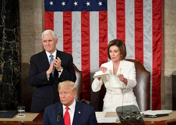 PHOTO: Vice President Mike Pence claps as Speaker of the House of Representatives Nancy Pelosi rips a copy of President Donald Trump's speech after he delivers the State of the Union address in Washington, D.C., Feb. 4, 2020. (Mandel Ngan/AFP via Getty Images, FILE)