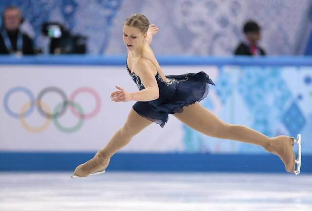 Nicole Rajicova of Slovakia competes in the women's short program figure skating competition at the Iceberg Skating Palace during the 2014 Winter Olympics, Wednesday, Feb. 19, 2014, in Sochi, Russia. (AP Photo/Ivan Sekretarev)
