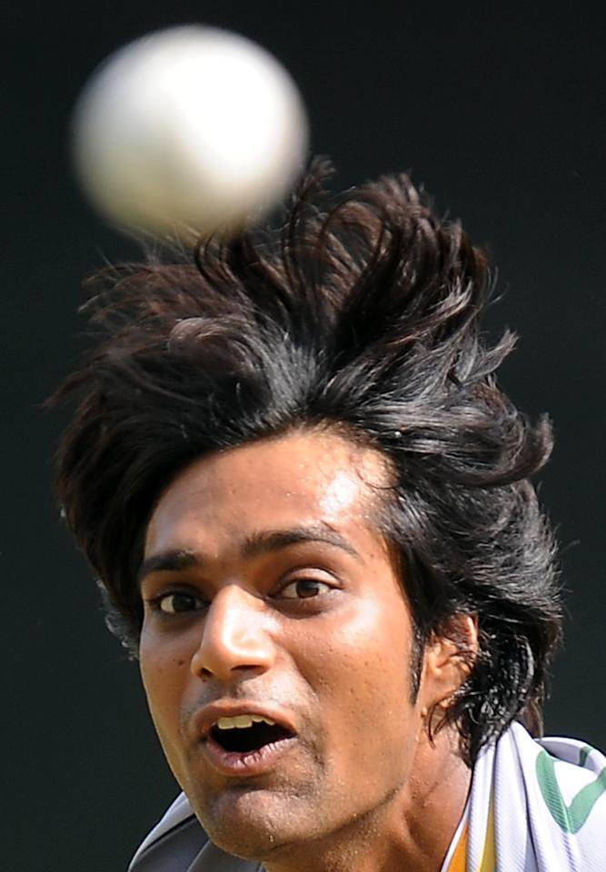 Pakistan cricketer Rahat Ali delivers a ball during a practice session at the Pallekele International Cricket Stadium in Pallekele on June 8, 2012.  The second one-dayer will be played in Pallekele on June 9 and the last three games in Colombo on June 13, 16 and 18. AFP PHOTO/ LAKRUWAN WANNIARACHCHI