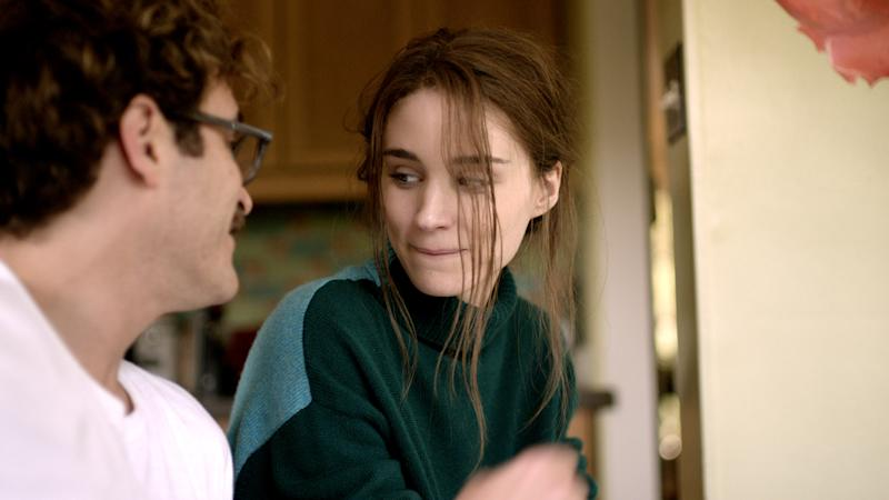 """This image released by Warner Bros. Pictures shows Joaquin Phoenix, left, and Mara Rooney in a scene from """"Her."""" (AP Photo/Warner Bros. Pictures)"""