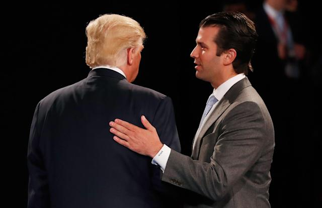 Donald Trump, Jr. greets his father, then on the campaign trail in St. Louis, October 2016. (Photo: Rick Wilking/Getty Images)
