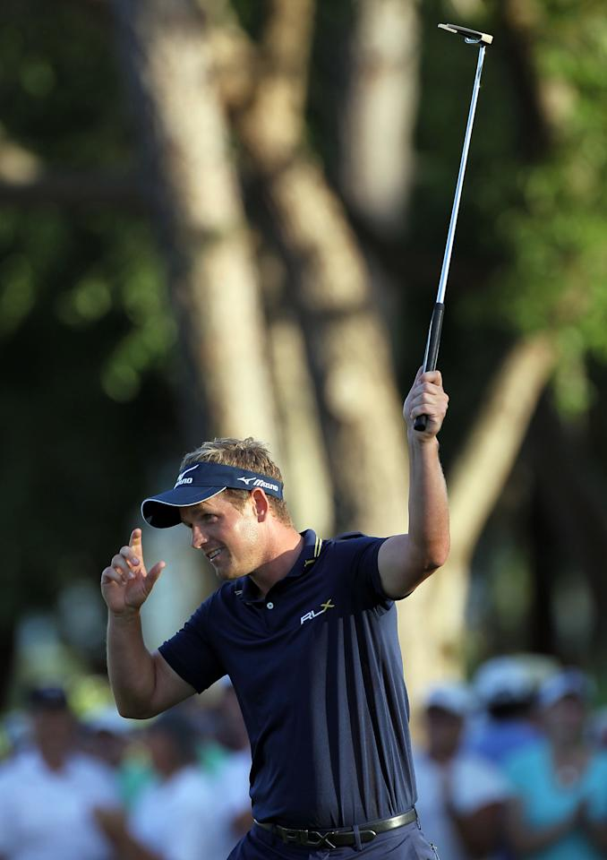 PALM HARBOR, FL - MARCH 18:  Luke Donald of England reacts to winning the Transitions Championship in a playoff at the Innisbrook Resort and Golf Club  on March 18, 2012 in Palm Harbor, Florida.  (Photo by Sam Greenwood/Getty Images)