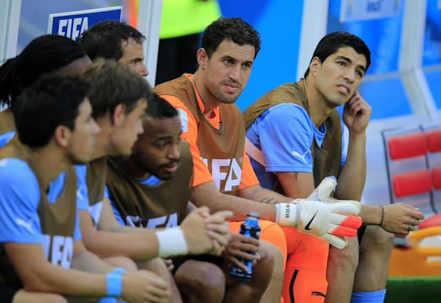 Uruguay's Luis Suarez, right, sits on the bench ahead of the group D World Cup soccer match between Uruguay and Costa Rica at the Arena Castelao in Fortaleza, Brazil, Saturday, June 14, 2014. (AP Photo/Bernat Armangue)