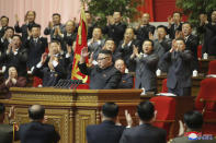 """In this photo provided by the North Korean government, North Korean leader Kim Jong Un, center, acknowledges to the applauds after he made his closing remarks at a ruling party congress in Pyongyang, North Korea Tuesday, Jan. 12, 2021. Kim vowed all-out efforts to bolster his country's nuclear deterrent during the major ruling party meeting where he earlier laid out plans to work toward salvaging the broken economy. Independent journalists were not given access to cover the event depicted in this image distributed by the North Korean government. The content of this image is as provided and cannot be independently verified. Korean language watermark on image as provided by source reads: """"KCNA"""" which is the abbreviation for Korean Central News Agency. (Korean Central News Agency/Korea News Service via AP)"""