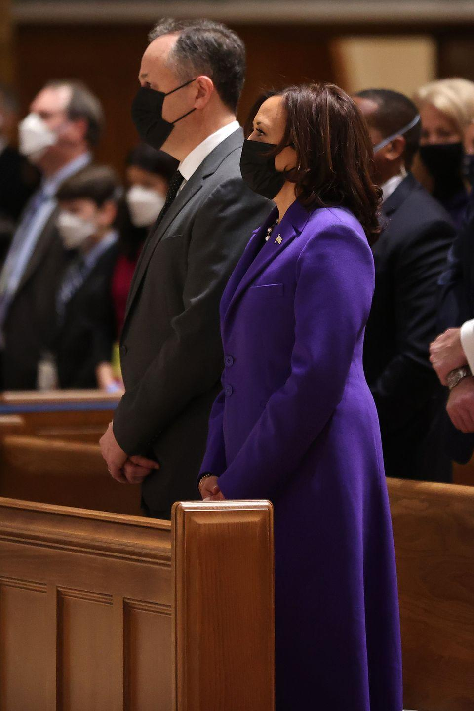 """<p>Vice President-elect Kamala Harris and her husband, Doug Emhoff, attend services at the Cathedral of St. Matthew the Apostle with congressional leaders prior to the 59th presidential inauguration ceremony. Harris wears a purple coat <a href=""""https://www.harpersbazaar.com/celebrity/latest/a35264948/kamala-harris-christopher-john-rogers-inauguration/"""" rel=""""nofollow noopener"""" target=""""_blank"""" data-ylk=""""slk:designed by Christopher John Rogers"""" class=""""link rapid-noclick-resp"""">designed by Christopher John Rogers</a>. </p>"""