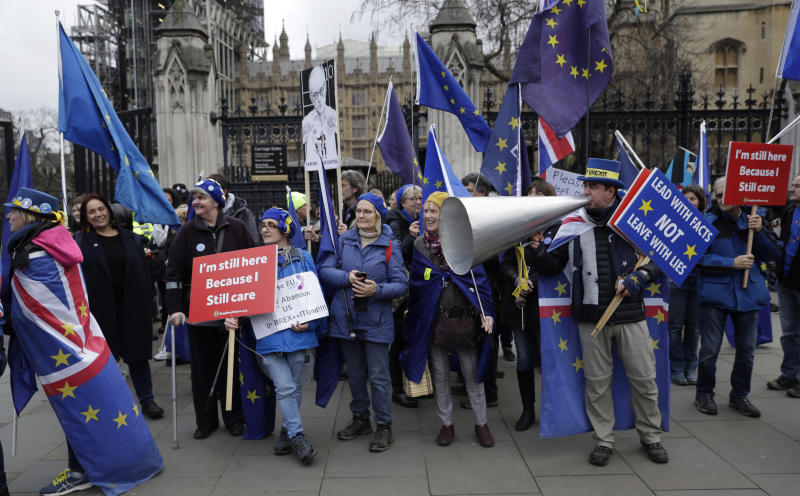 """Remain in the European Union, anti-Brexit protesters, including Steve Bray, at right, demonstrate outside the Houses of Parliament in London, on the day of Prime Minister's Questions taking place inside, Wednesday, Jan. 8, 2020. In a London speech on Wednesday, the president of the European Commission Ursula von der Leyen warned Britain that it won't get the """"highest quality access"""" to the European Union's market after Brexit unless it makes major concessions. (AP Photo/Matt Dunham)"""