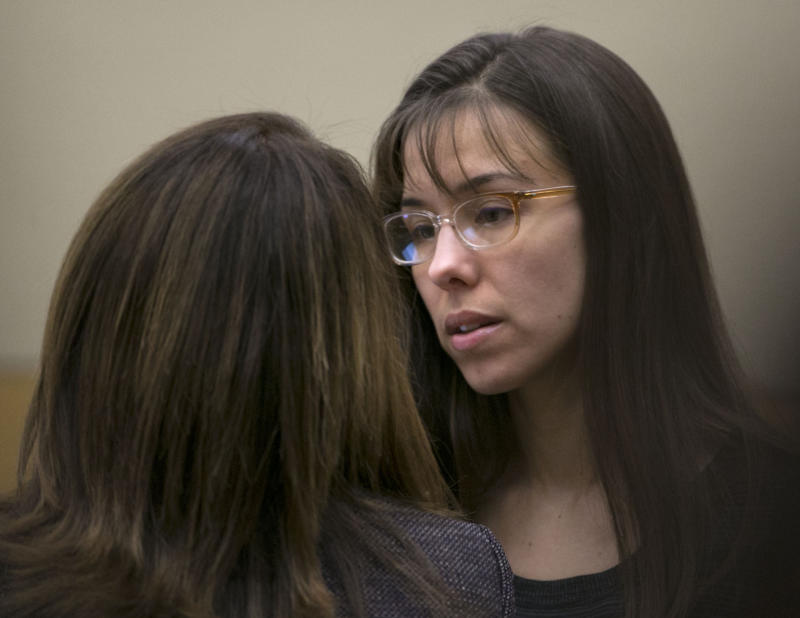 Defendant Jodi Arias, right,  talks to her attorney, Jennifer Wilmott during her trial at Maricopa County Superior Court in Phoenix on Thursday, April 11, 2013.   Arias is on trial for the killing of her boyfriend, Travis Alexander, in 2008.  Arias faces a possible death sentence if convicted of first-degree murder.  (AP Photo/The Arizona Republic, David Wallace, Pool)