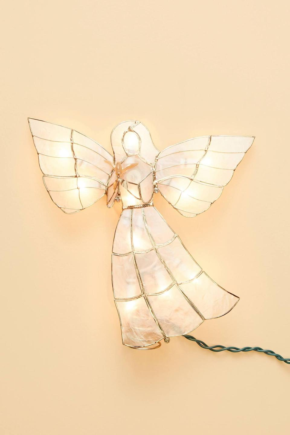 """<p>The <a href=""""https://www.popsugar.com/buy/Illuminated-Angel-Tree-Topper-490527?p_name=Illuminated%20Angel%20Tree%20Topper&retailer=anthropologie.com&pid=490527&price=38&evar1=casa%3Aus&evar9=46615300&evar98=https%3A%2F%2Fwww.popsugar.com%2Fhome%2Fphoto-gallery%2F46615300%2Fimage%2F46615397%2FIlluminated-Angel-Tree-Topper&list1=shopping%2Canthropologie%2Choliday%2Cchristmas%2Cchristmas%20decorations%2Choliday%20decor%2Chome%20shopping&prop13=mobile&pdata=1"""" rel=""""nofollow noopener"""" class=""""link rapid-noclick-resp"""" target=""""_blank"""" data-ylk=""""slk:Illuminated Angel Tree Topper"""">Illuminated Angel Tree Topper</a> ($38) is so calming to look at. </p>"""