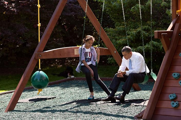 """President Obama talks with his daughter Malia on the swing set outside the Oval Office, May 4, 2010. (Pete Souza / The White House) <br> <br> <a href=""""http://lightbox.time.com/2012/10/08/pete-souza-portrait-of-a-presidency/#1"""" rel=""""nofollow noopener"""" target=""""_blank"""" data-ylk=""""slk:Click here to see the full collection at TIME.com"""" class=""""link rapid-noclick-resp"""">Click here to see the full collection at TIME.com</a>"""
